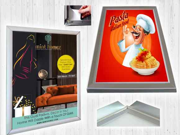 an aluminium poster frame can be easily operated by simply snapping open the side profiles pulling out the old poster putting in the new one and closing edges as shown in this image