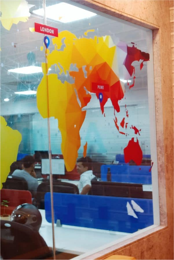 UV printed optically clear glass film print of the world map where the image of the continents is opaque and the rest of the area is transparent