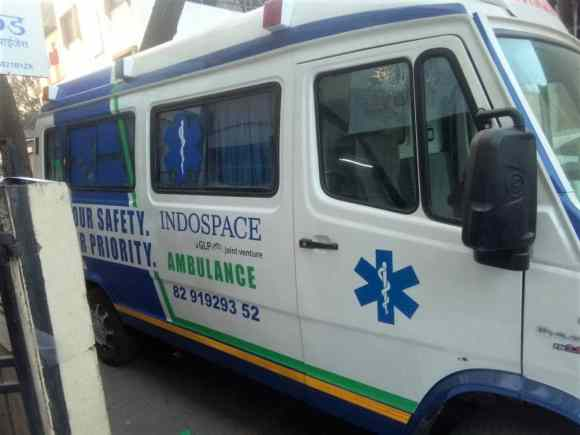 Side view of an ambulance of the Indospace company personalised by special UV printed vehicle wraps