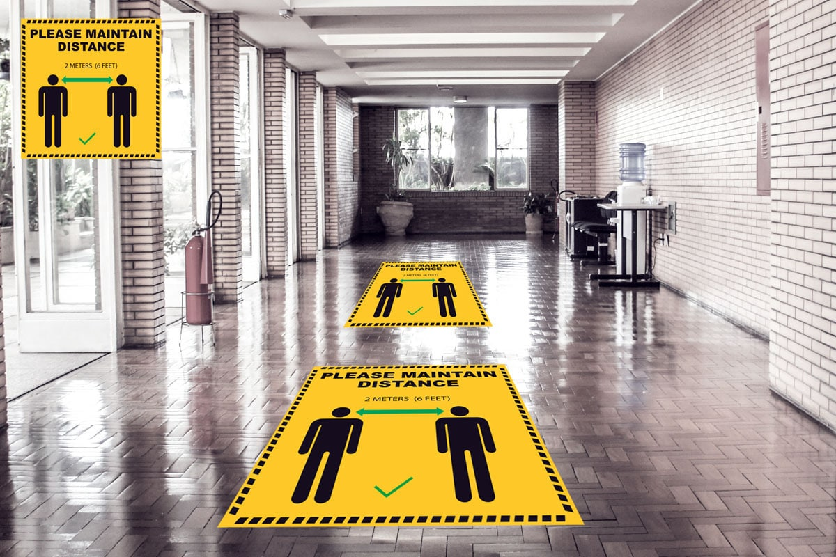 floor stickers and graphics for social distancing asking you to maintain 6 feet distance which are pasted on the ground