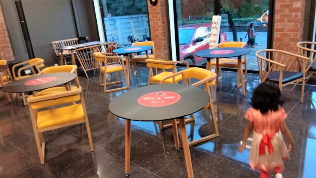 vinyl record images printed on the table top of a themed music cafe
