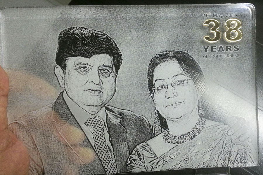 Picture of a middle aged couple laser engraved on a clear acrylic sheet to create a highly unique photo frame