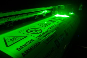 night glow safety signs being printed on a UV inkjet wide format printer