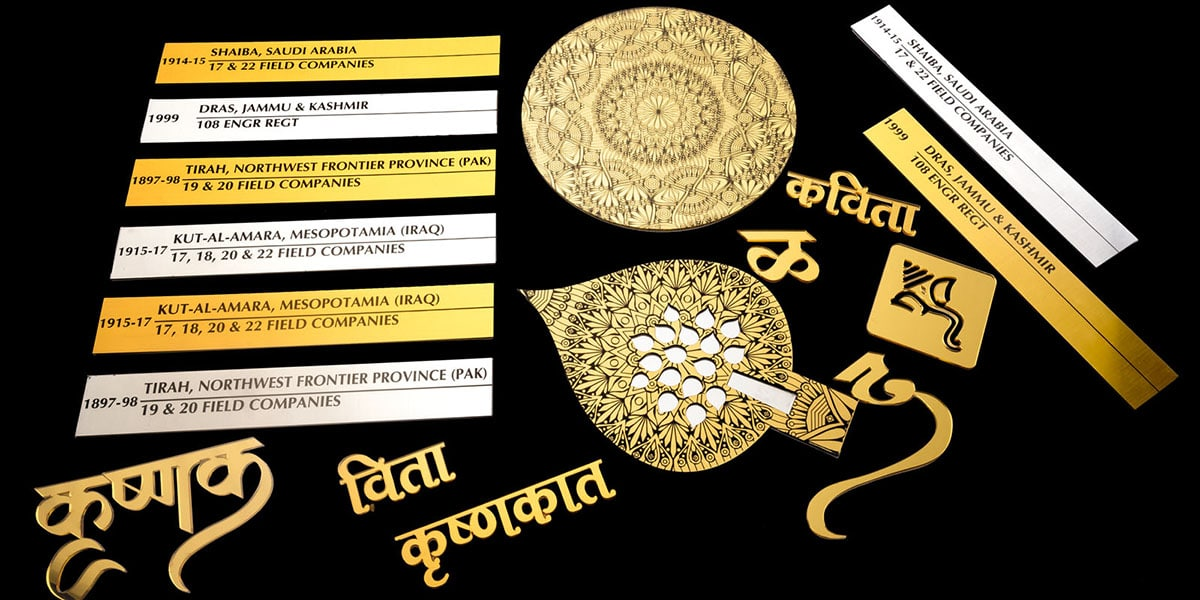 Gold and silver name plates laser engraved. Trophies cut from gold ply. Ganpati logo and marathi letters made from gold acrylic.