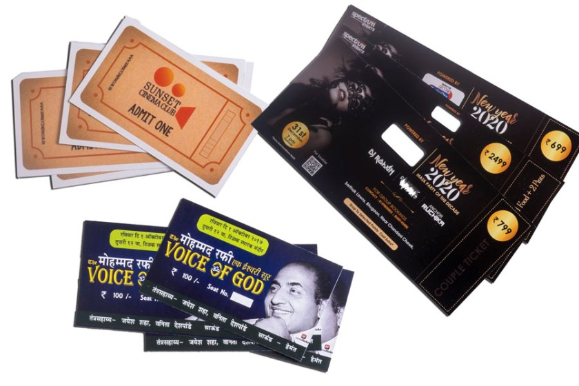 three event tickets digitally printed on a colour printer and spread out for display
