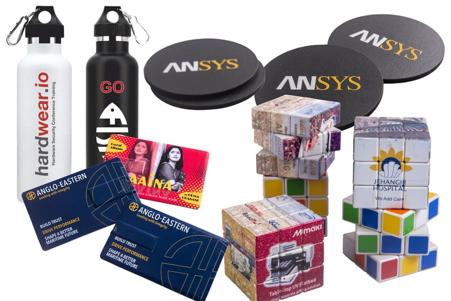 collage of UV printed personalised corporate gifts like a USB drive, tea coasters and rubik's cube