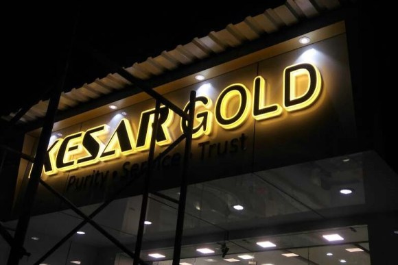 LED acrylic board for the Kesar Gold Jewellery store. Laser cut letters beautifully glowing from the sides and front with a warm white glow and outlining black acrylic letters on the front