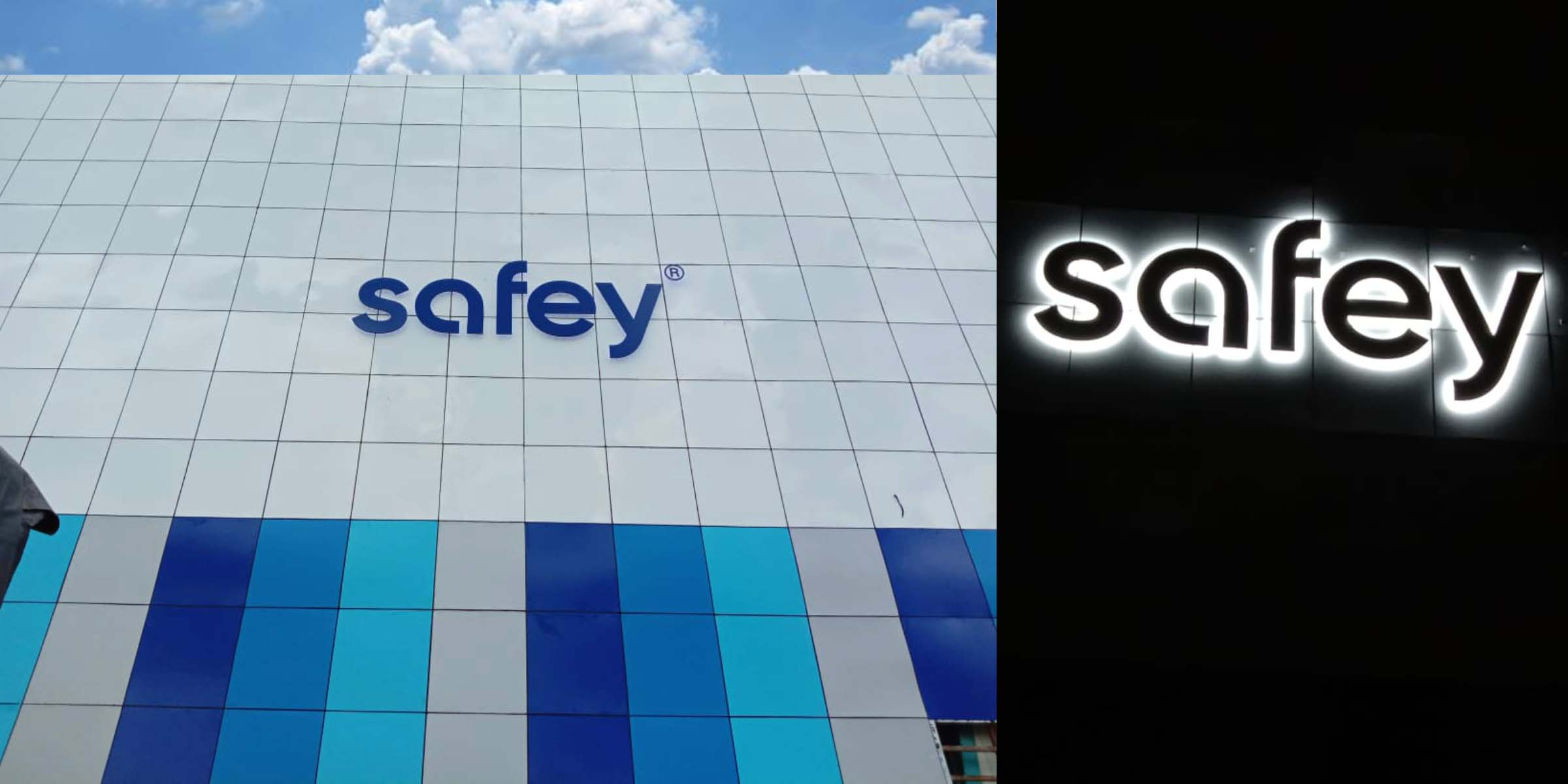 Day and night view of a metal letter sky sign for the Safey company fixed on the side of a very tall building