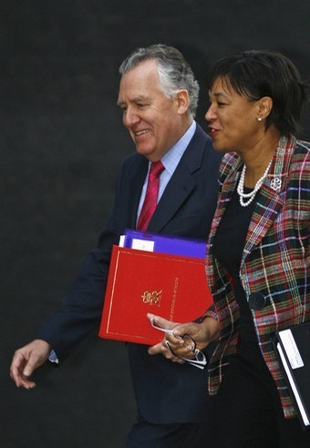 Britain's Attorney General Baroness Scotland and Secretary of State for Wales Peter Hain arrive at Downing Street.