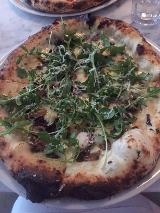 Funghi pizza bianche ($15): porcini mushrooms, smoked mozzarella, arugula and parmigiano