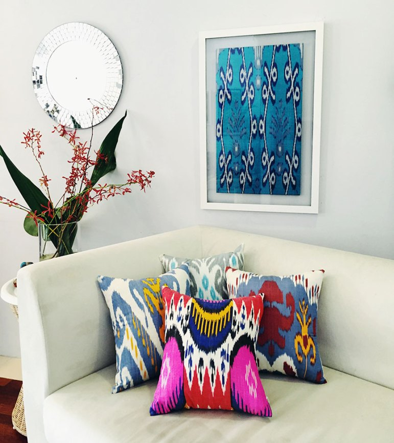 Frankitas gorgeous home furnishings. Seen here, Ikat cushions and framed piece.