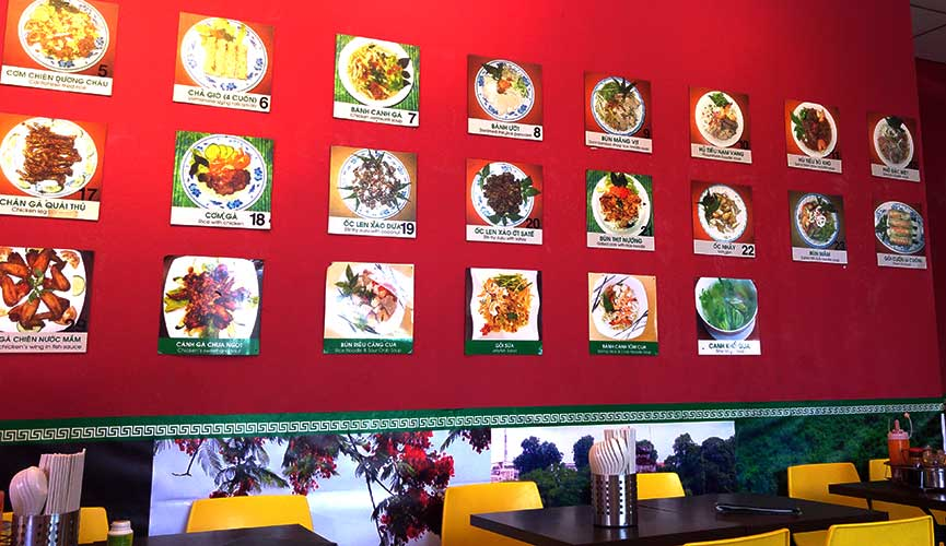 The wall at Long Phung with some of their dishes on offer.