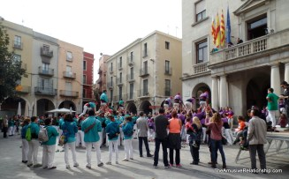 Two groups creating a traditional, Catalonian human tower