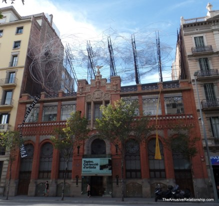 A wire sculpture atop a building