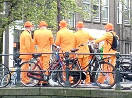 Some of the many bright orange outfits worn for the holiday