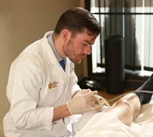 Dr. Sam Oltman treating a patient with PRP prolotherapy, a regenerative injection treatment