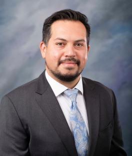 Dr. Kristian Flores