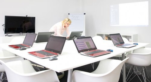 image of lady typing on laptop