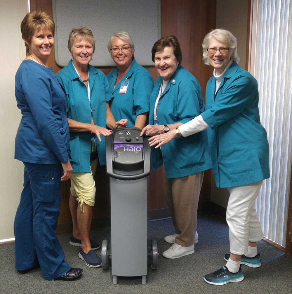 From left, Geneva Stange, RN, who oversees infection prevention at Samaritan North Lincoln Hospital, and SNLH Auxiliary volunteers Suzy Lazott, Karen Andreika, Marguerite Cooper and Dorothy Rogers show off the new Halo Fogger disinfectant system now in use at the hospital.