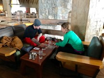 Cute couple playing cards at Timberline