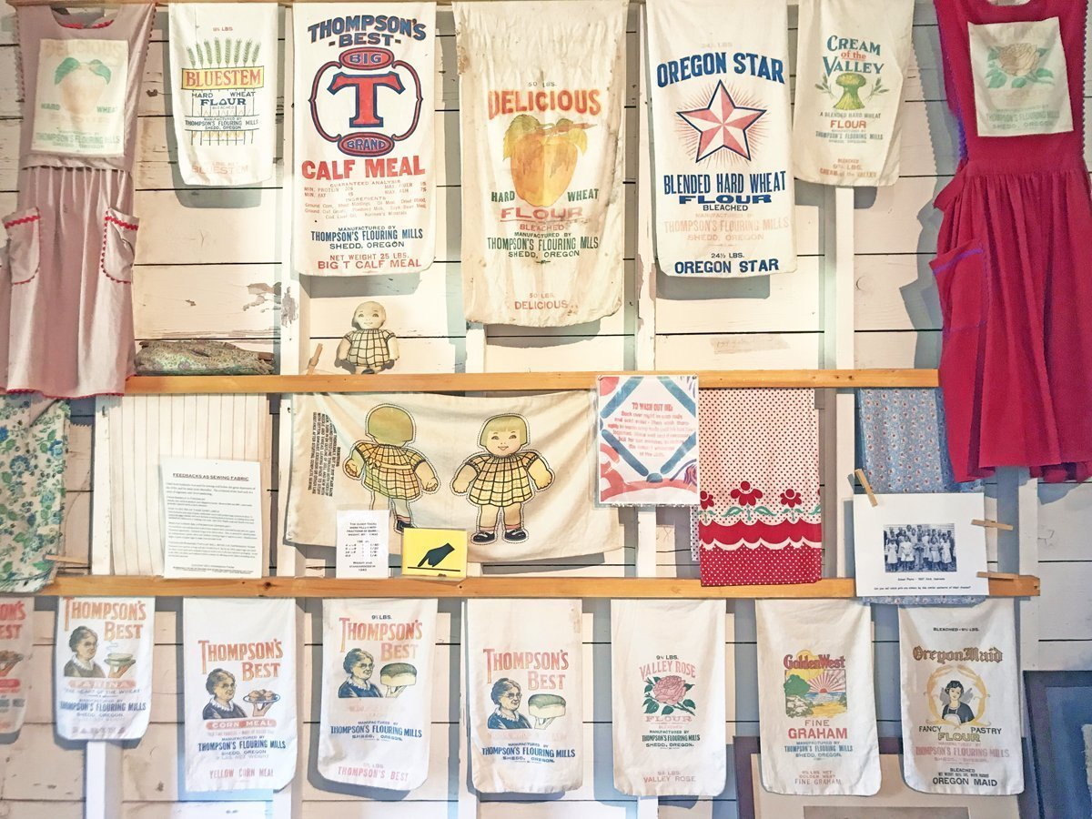 Colorful display of historic flour sacks, including printed sacks used for their fabric