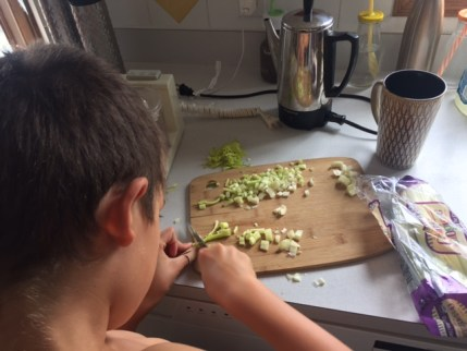 My son learning how to cook