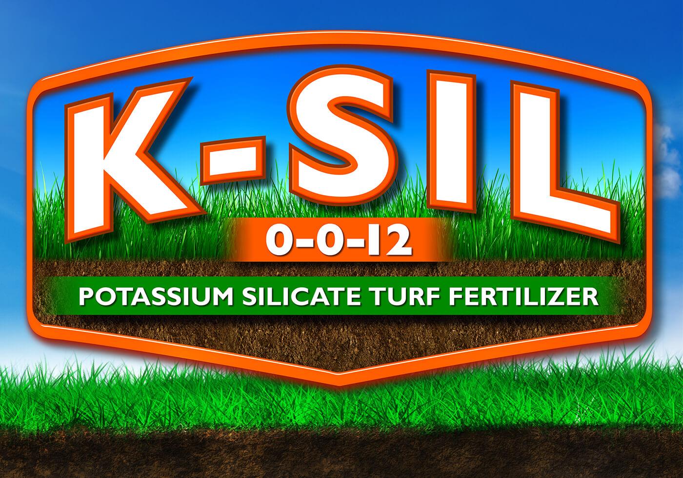 large orange k-sil 0-0-12 logo supplemental potassium silicate fertilizer over blue sky background grass and dirt