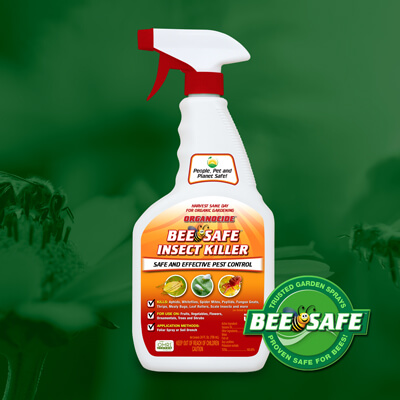 red orange and white 24 ounce spray nozzle container of bee safe organic insect killer over green flowers and bees