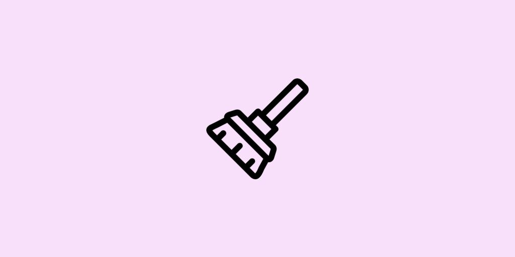 Broom on pink background