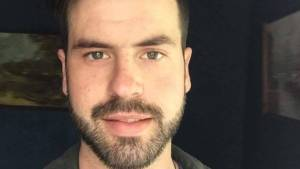 Close-up image of police shooting victim Jerrim Toms, killed on 31 March 2018 - a white 29-year-old man with a short brown beard and kind eyes.