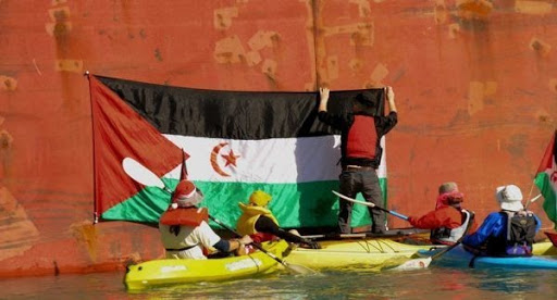 Protesters in Lyttelton attach a Saharawi flag to Ravensdown ship, the Federal Crimson.