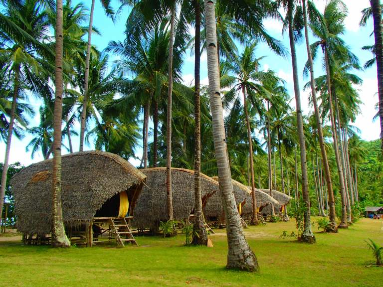 Accomodations in beach front huts on remote islands with Tao Philippines