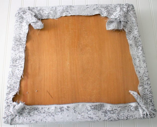 staple fabric to cushion