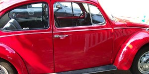 Side of red VW Bug