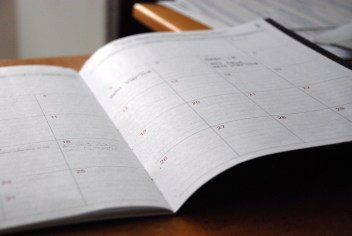 A close-up of an open monthly planner