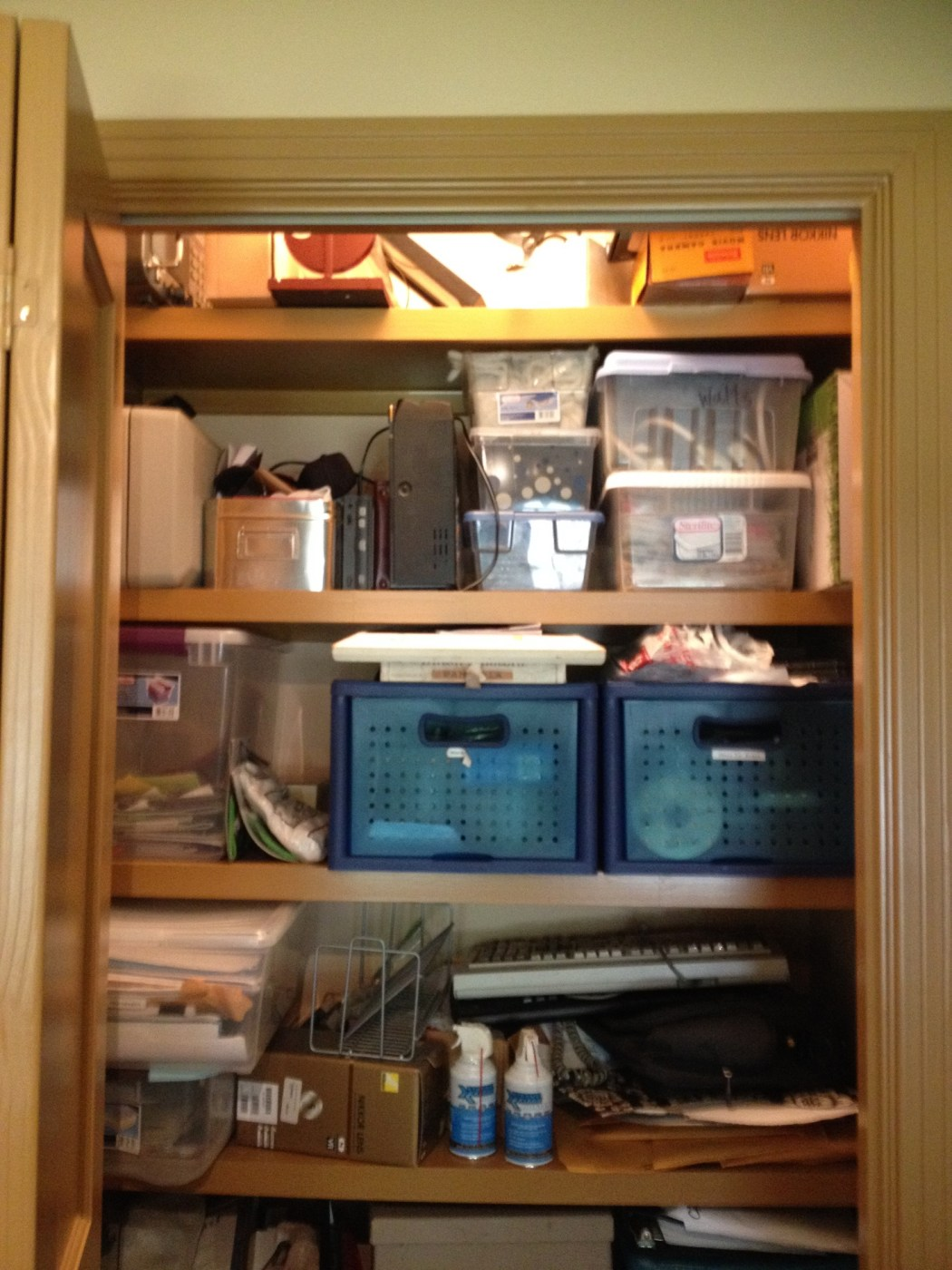 Purging Outdated Technology in a Home Office Closet  - Cluttered Top View of Home Office Closet