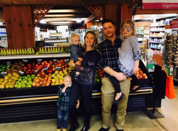 Jim Gannon and Danielle Gannon with their three children inside Organnons Natural Market