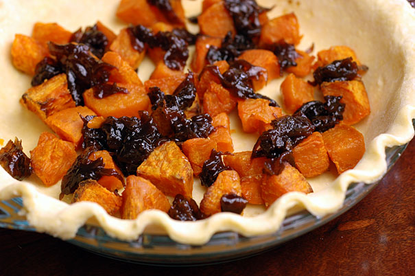 making a sweet potato and caramelized onion quiche