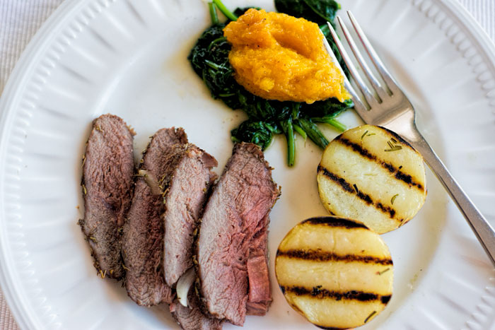 Lamb sirloin roast with rosemary and thyme.