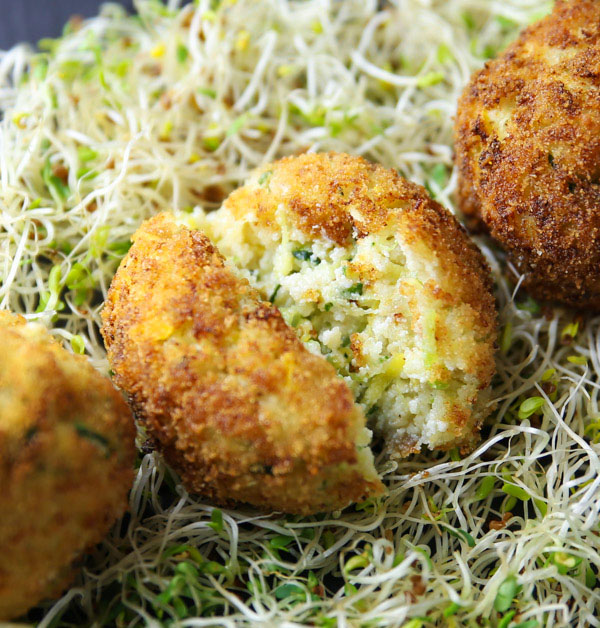 These Zucchini and Yellow Squash Ricotta Fried Balls will be your new favorite appetizer! These are so easy to make and are loaded with flavor!