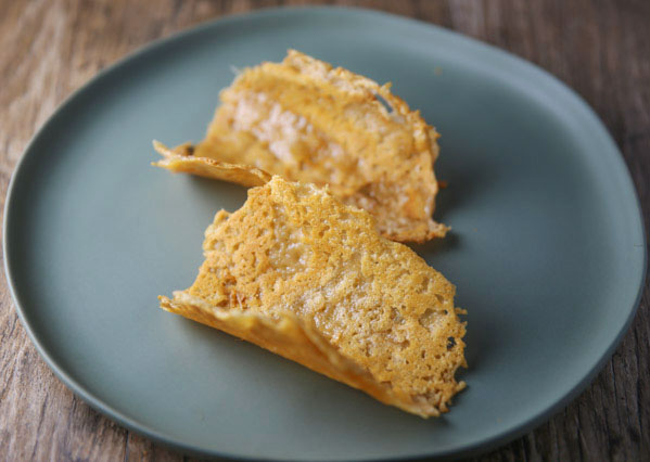 How To Make Vegan Parmesan Taco Shells (Parmos!) - Using Vegan Parmesan Cheese to make these taco shells is so easy and will really kick up your taco night a notch!