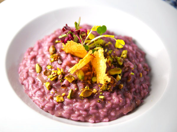 This Fruits of Forest Risotto with Chocolate EVOO puts a unique spin on Risotto by infusing it with the many different fruits of the forest! Drizzled with Chocolate EVOO and topped with crumbled Pistachios, this will leave your palate wanting more after each and every bite!