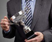 image of man holding an award