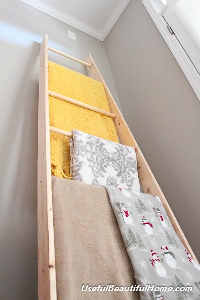 DIY ladder for organizing blankets