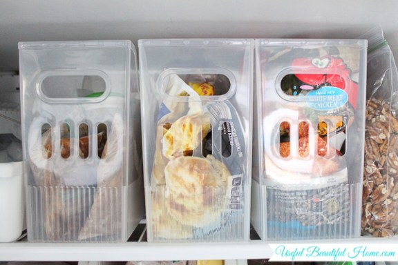 compact storage bins for organizing a top freezer