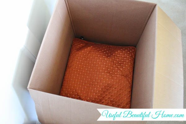 Use pillows adn linens as extra padding inside your moving boxes