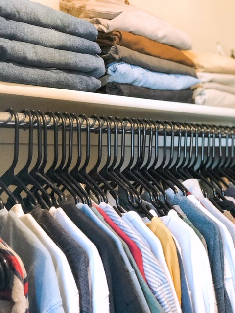 closet organizing in a boy's room