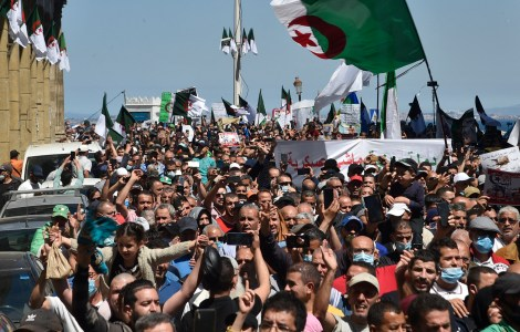 Algerians shout slogans during an anti-government demonstration in the capital Algiers on May 7, 2021. (Photo by RYAD KRAMDI / AFP)