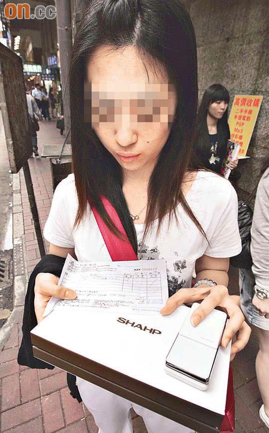 內地女遊客被呃買山寨手機 - 東方日報