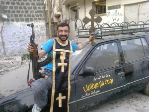 """A Syrian """"freedom fighter"""" is posing  with """"trophies""""--a cross and epitrachelion from a desecrated church. Source: pravoslavie.ru"""